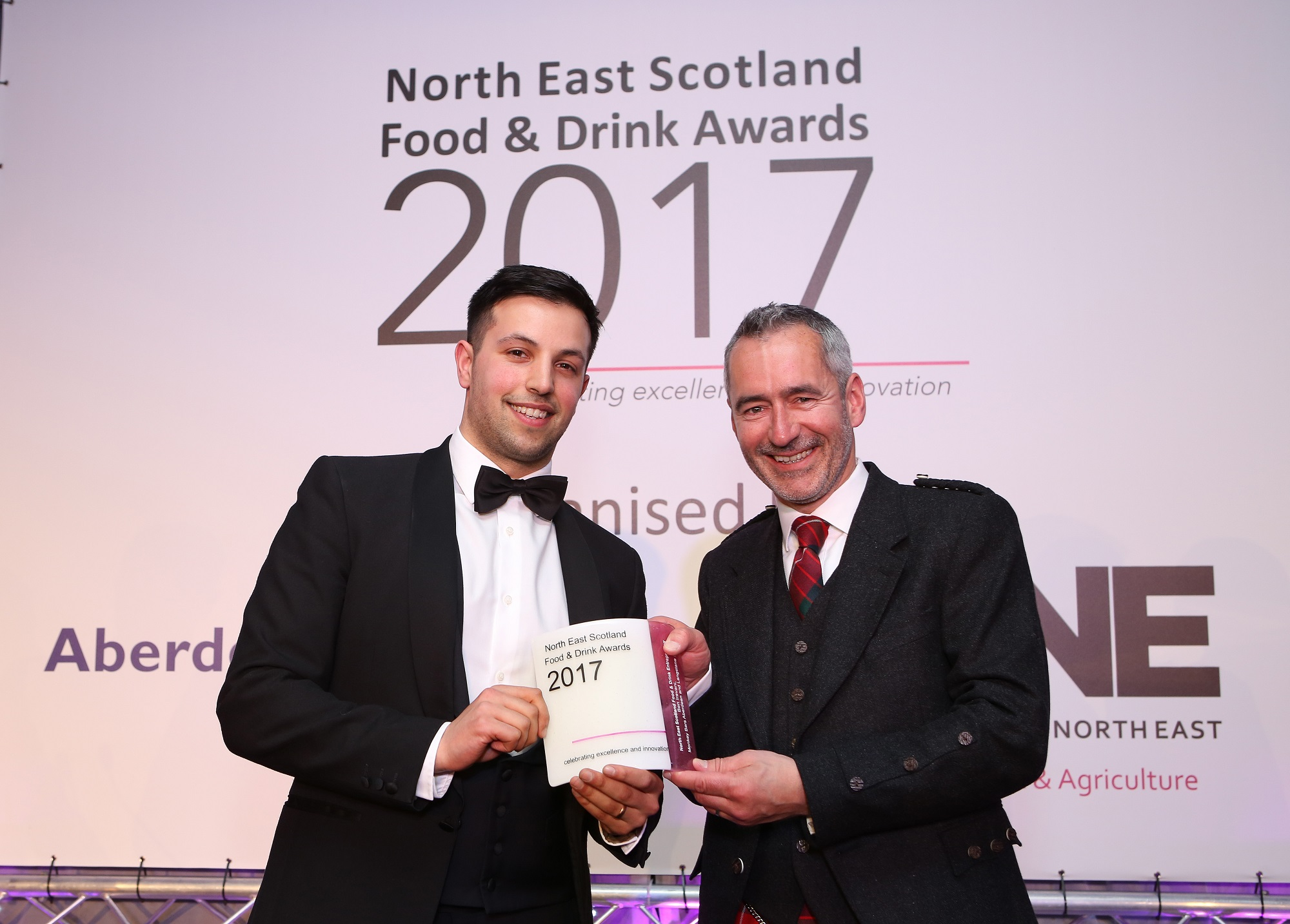 Pictured: Ben Iravani receiving the award from Graeme Fraser